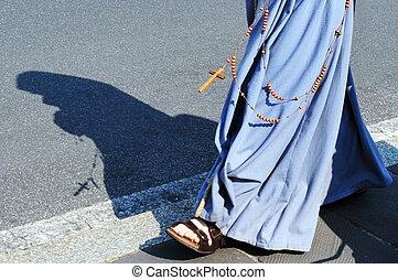 Catholic nun  walks at Vatican city in Rome Italy.