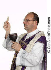 Catholic priest during communion in worship