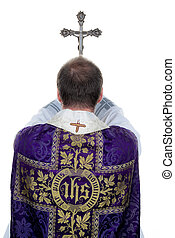 A Catholic priest at prayer