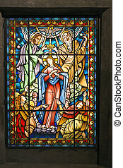 Catholic stained glass window from a church of the north of Portugal