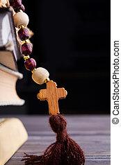 Catolic roman rosary with wooden cross.