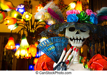 Catrina representation in Mexico, in front of a shop