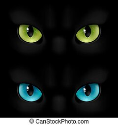 Cats eyes - Green and blue cats eyes on a black background