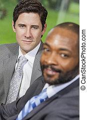 Caucasian & African American Businessman in Office Meeting