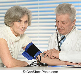 Caucasian aged doctor with a elderly patient