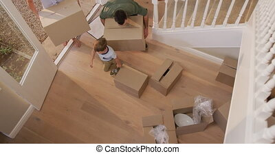 Caucasian attractive couple moving into new house