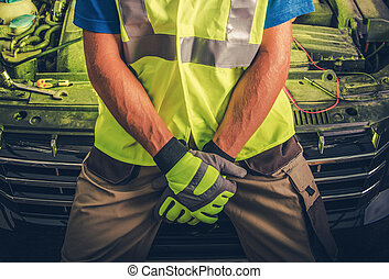 Automotive Car Mechanic in Front of Vehicle