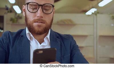 caucasian bearded guy use mobile