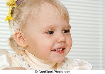 Caucasian beautiful baby sitting