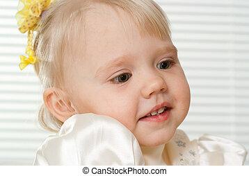 Caucasian beautiful toddler sitting