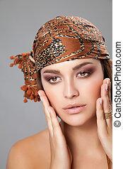 Young caucasian beauty wearing a headscarf