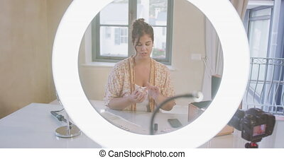 Caucasian blogger woman doing a video at home - Caucasian ...