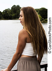 Caucasian Blond Teen Woman Looking At River