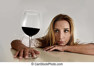 caucasian blond wasted depressed alcoholic woman drinking red wine glass alcohol addiction