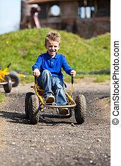 Caucasian boy having fun in moon buggy