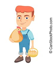 Caucasian boy holding a chicken and hen eggs.