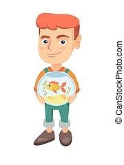 Caucasian boy holding aquarium with goldfish.