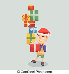 Caucasian boy holding christmas gift boxes.