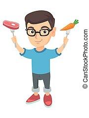 Caucasian boy holding fresh carrot and steak.