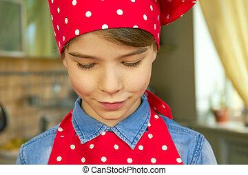 Caucasian boy in chef uniform.