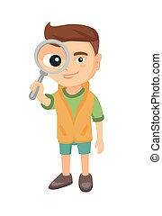 Caucasian boy looking through a magnifying glass.