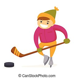 Caucasian boy playing hockey on outdoor rink.