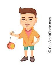 Caucasian boy playing with yo-yo.