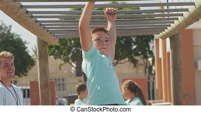 Caucasian boy training at boot camp - Front view close up of...