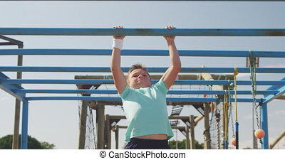 Caucasian boy training at boot camp - Front view of a happy ...