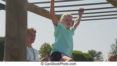Caucasian boy training at boot camp - Side view of a happy ...