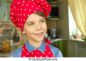 Caucasian boy wearing chef hat.