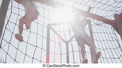 Caucasian boys training at boot camp - Low angle view of two...