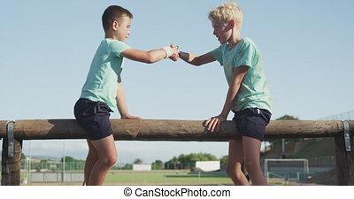 Caucasian boys training at boot camp