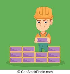 Caucasian bricklayer boy building a brick wall.