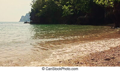 Caucasian Bride in Long Groom Run into Azure Sea