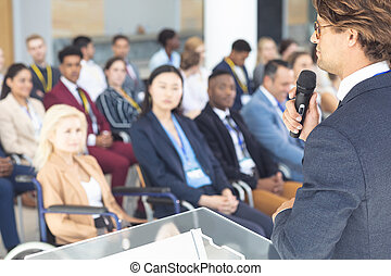 Caucasian businessman doing speech in conference room