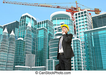 Caucasian Businessman use Digital Mobile phone at Construction Site