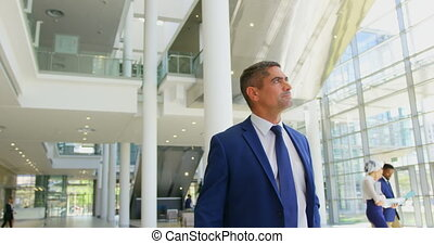 Caucasian businessman walking in the lobby at office 4k - ...