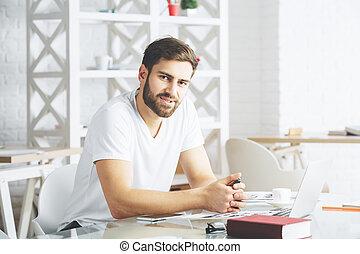 Caucasian businessperson using laptop