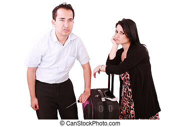 caucasian businesswoman and businessman stand impatiently as they wait for a flight
