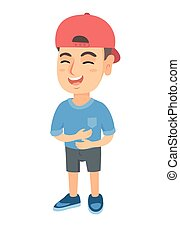 Caucasian cheerful boy in a cap laughing.