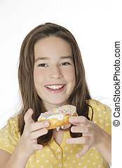 Caucasian Child - Cute Caucasian girl eating a donut on a ...