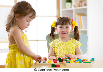 Caucasian child sisters playing together