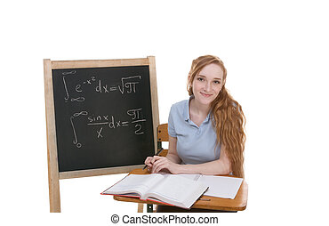 Caucasian college student by blackboard studying for math exam