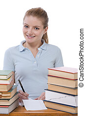 Caucasian college student woman by stack of books
