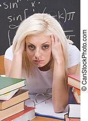 Caucasian college student woman studying math exam