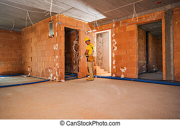 Caucasian Construction Worker Finishing Building Interior