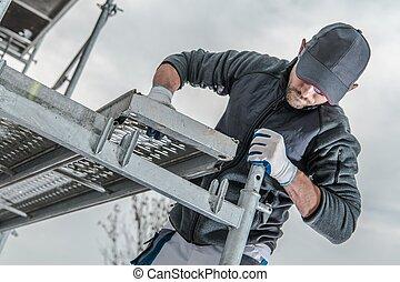 Worker Installing Scaffolding - Caucasian Construction ...
