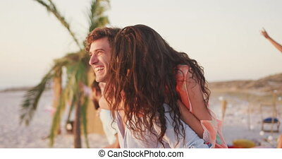 Caucasian couple enjoying a party on the beach - Front view ...