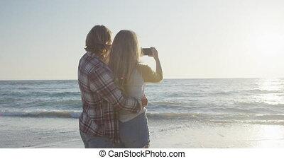 Caucasian couple enjoying their time seaside - A Caucasian ...